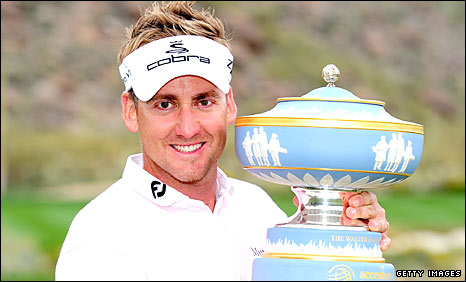 Ian Poulter celebrates with the trophy