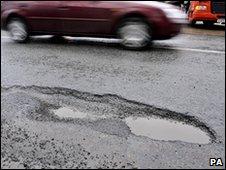 Car passes a pothole in Bristol