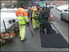 Gang repairing potholes