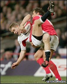 Gavin Henson tackles Mathew Tait in the 2005 Six Nations