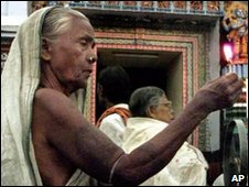 A Hindu woman in prayer at the Jagannath temple in Puri