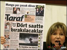 Turkish opposition MP Nur Serter holds up copy of Taraf newspaper