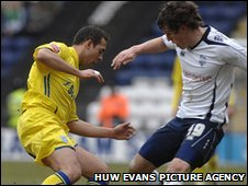 Preston's Billy Jones challenges Cardiff's Michael Chopra