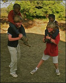 Geoff Whittle's children, playing with two Indian boys. Copyright of Geoff Whittle.