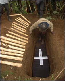 A villager buries a dead relative, 03/03