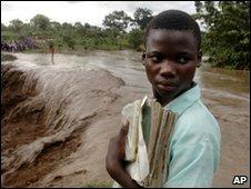 A boy holding school books near near the village of Bukalasa, eastern Uganda