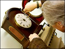 Viscount Alan Midleton winds one of the many clocks at the BHI