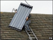 Man fitting solar panel