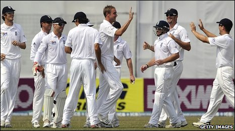 England celebrate Stuart Broad's first wicket