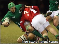Ireland's Orla Brennan is tackled by Welsh prop Jenny Davies