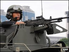 An Indonesian army commando mans a machinegun in Jakarta on 11 March 2010