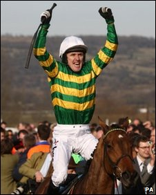 Tony McCoy celebrates victory on Binocular