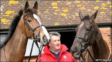 Trainer Paul Nicholls with his Cheltenham Gold Cup winning horses Kauto Star (left) and Denman