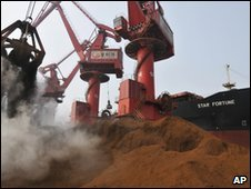 A crane drops iron ore imported from Australia at Rizhao port in China (file image)