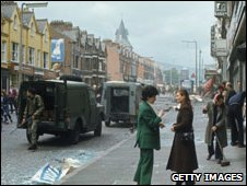 A  British Army patrol arrives in the aftermath of a bomb blast in Belfast, Northern Ireland