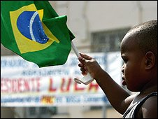 A child waving a Brazilian flag