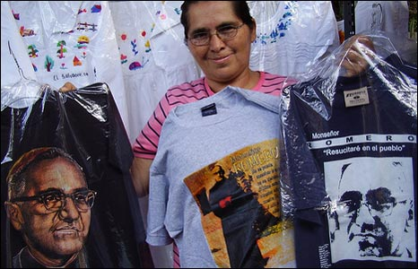 A woman sells T-shirts printed with Archbishop Romero's image