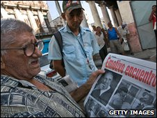 A Cuban reads a newspaper in Havana