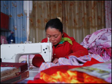 Wang Ping makes curtains at her shop