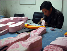 A worker at the shoe moulding factory