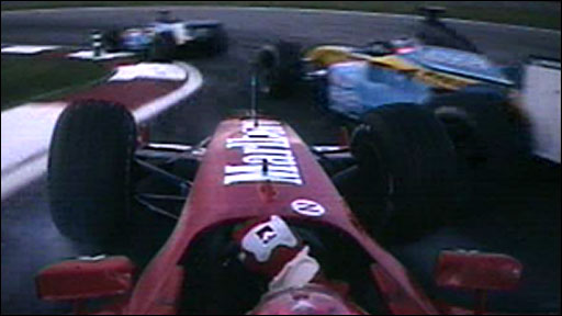 Michael Schumacher collides with Jarno Trulli