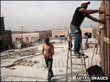 Palestinian laborers work on a construction site in the east Jerusalem settlement of Ramat Shlomo