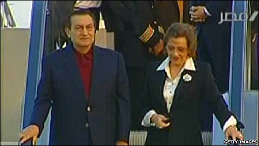 Egyptian President Hosni Mubarak and his wife Susan getting off plane