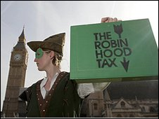 "A protestor from the ""Robin Hood Tax Campaign,"" dressed as ""Robin Hood,"""