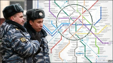 Russian police stand near a map of the Moscow Metro outside Lubyanka station, 29 March, 2010