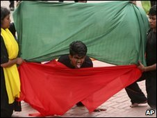 "Bangladeshis perform a street theatre on ""war criminals"" to mark the country�s Independence Day, in Saver, on the outskirts of Dhaka, Bangladesh, Friday, March 26, 2010"