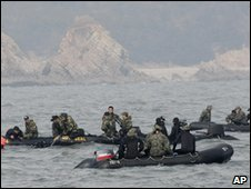 Dive teams search the wreck site on 30 March 2010