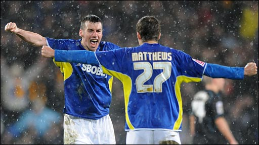 Paul Quinn celebrates the win with Adam Matthews
