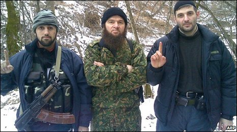 Chechen rebel leader Doku Umarov (centre) poses with two unidentified militants (undated photo)