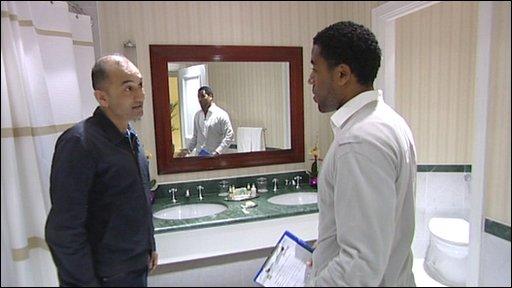 Marriott hotel inspector speaking to Rajan Datar (r)