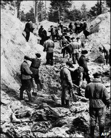 A picture taken on April 1, 1943 shows men digging out bodies of Polish officers from a mass grave in Katyn