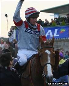 Tom O'Brien celebrates his Welsh National win on Dream Alliance