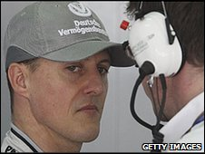 Michael Schumacher and race engineer Andrew Shovlin (right)
