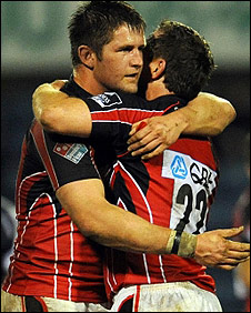Ernst Joubert and Glen Jackson celebrate for Saracens