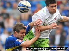 Reading's Shane Long rises above Cardiff City midfielder Stephen McPhail