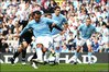 Craig Bellamy looks on as team-mate Carlos Tevez slots a penalty for Manchester City against Birmingham