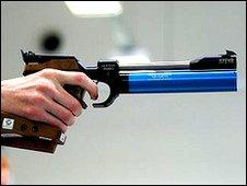 Pentathlete holding air pistol
