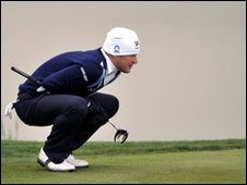 Jamie Donaldson  lines up a putt on the 16th green at the China Open
