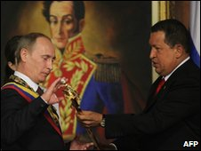 Russian Prime Minsiter Vladimir Putin (left) and Venezuelan President Hugo Chavez (right)
