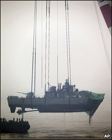 An offshore crane salvages a portion of the sunken South Korean naval ship