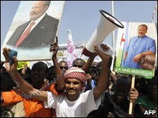 Supporters of Djiboutian President Ismael Omar Guelleh hold up posters and cheer outside of the National Assembly on April 19, 2010 in Djibouti