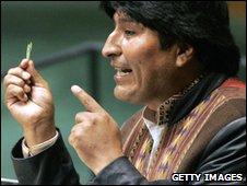 Evo Morales holding a coca leaf