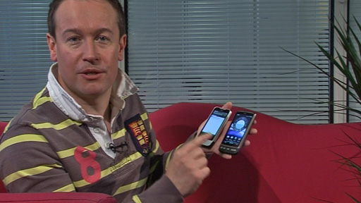 Dan Simmons holding the HTC Legend and the HTC Desire mobile phones