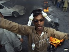A man with light bulbs tied to his head at a power protest in Lahore - April 10 2010.