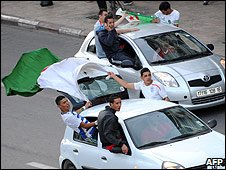 Algerian fans celebrate Algeria qualifying for the 2010 World Cup