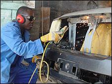 Man working on Apostle Asafo's limosine